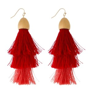 """Gold tone, fishhook earrings with a large, ombre, statement tassel. Approximately 4"""" in length."""