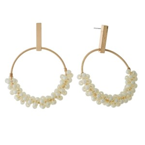 """Gold tone stud earrings with an open circle shape and wire-wrapped pearl beads. Approximately 2"""" in length."""
