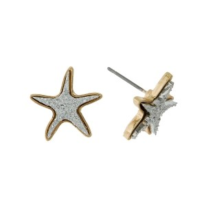 "Gold tone starfish earrings with a faux druzy stone. Approximately 1/2"" in size."