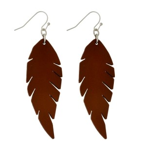 """Silver tone, fishhook earrings with a faux leather feather. Approximately 2.5"""" in length."""
