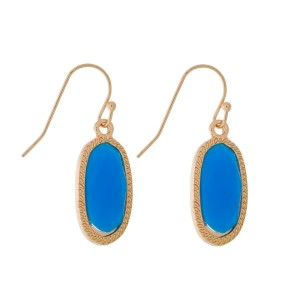 """Dainty gold tone fishhook earrings with an oval shaped, faceted stone. Approximately 1"""" in length."""