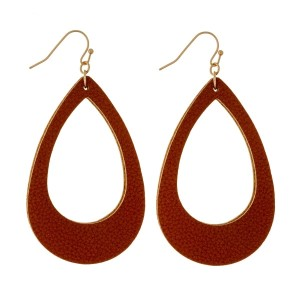 "Gold tone fishhook earrings with a faux leather, teardrop shape. Approximately 2.25"" in length."
