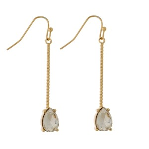 """Gold tone, fishhook earrings with a textured bar and teardrop rhinestone. Approximately 2"""" in length."""