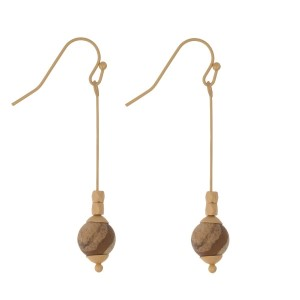 "Matte gold tone, fishhook earrings with a natural stone bead. Approximately 1.5"" in length. Natural stones may vary in color."