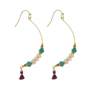 """Gold tone fishhook earrings with a half hoop, faceted beads, and a tassel accent. Approximately 2.25"""" in length. Handmade in the USA."""