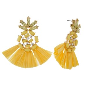 """Post style earrings with monochromatic rhinestones and raffia tassel. Approximately 2"""" in length."""