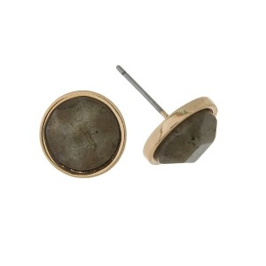 "Gold tone, circle stud earrings with a natural stone. Approximately 1/3"" in diameter."