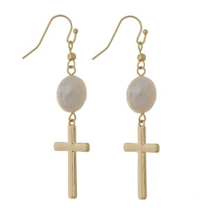 "Fishhook earrings with a cross focal and a freshwater pearl bead. Approximately 2"" in length."