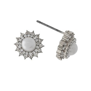 "Dainty pearl stud earrings with clear rhinestone accents. Approximately 1/3"" in size."