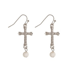 "Dainty cross earrings with clear rhinestones and a pearl bead. Approximately 1.5"" in length."
