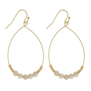 "Dainty gold tone, fishhook earrings with natural stone beads. Approximately 22"" in length."