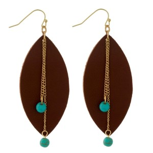 """Gold tone fishhook earrings with a faux leather oval shape and beaded accents. Approximately 3"""" in length."""