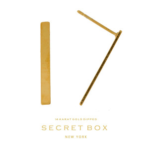 """Secret Box 14 karat gold dipped over brass bar stud earrings. Approximately 1"""" in length. Sold in a gift box."""