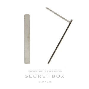"""Secret Box 24 karat white gold dipped over brass bar stud earrings. Approximately 1"""" in length. Sold in a gift box."""