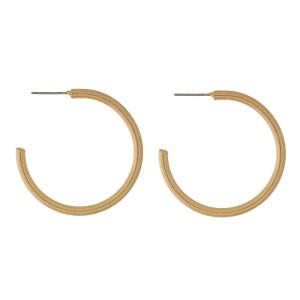 """Burnished metal hoop earrings. Approximately 1.5"""" in diameter."""