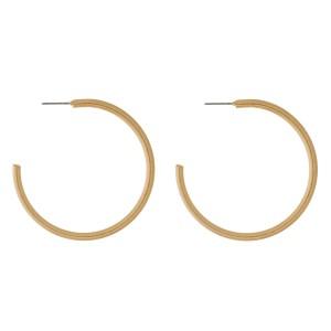 """Burnished metal hoop earrings. Approximately 2"""" in diameter."""