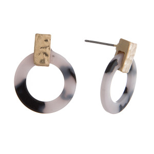 """Dainty stud earrings with a hammered gold tone circle and a tortoise circle. Approximately 1"""" in length."""