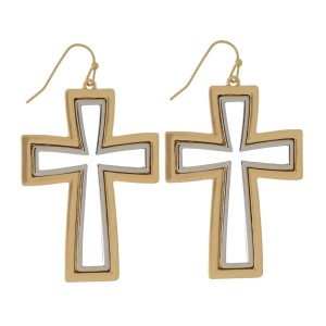 """Metal, fishhook earrings with a two tone cross. Approximately 2"""" in length."""