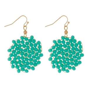 """Fishhook earrings with a wire-wrapped, beaded circle. Approximately 1.75"""" in length."""