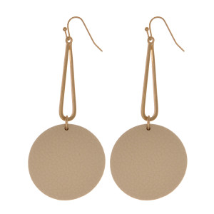 Gold tone, fishhook earring with leather, circle pendant.