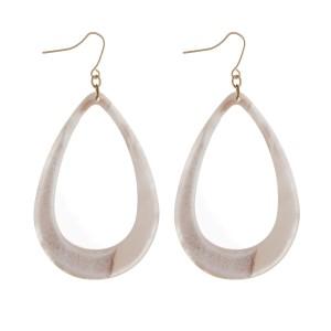 "Gold tone fishhook earrings with an acetate, teardrop shape. Approximately 2.5"" in length."