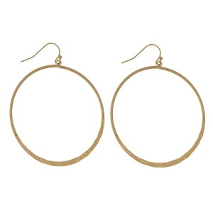 "Metal, fishhook earrings with circle shape. Approximately 1.5"" in length."