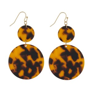 """Gold tone fishhook earrings with an acetate, circle shape. Approximately 2.5"""" in length."""