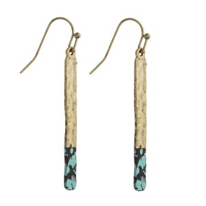 """Burnished metal fishhook earring with splatter paint accent. Approximately 2"""" in length."""