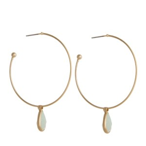 """Gold tone hoop earring with natural stone pendant. Approximately 1.5"""" in diameter."""
