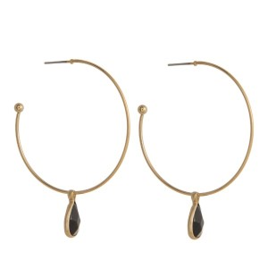 "Gold tone hoop earring with natural stone pendant. Approximately 1.5"" in diameter."
