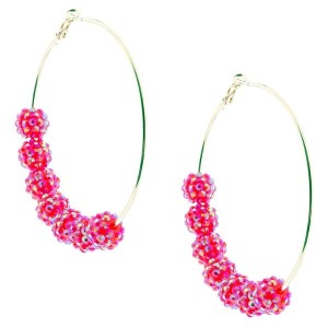 """3 1/4"""" Gold tone hoop style earrings featuring faceted fuchsia tone beads."""