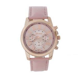Blush pink faux leather watch featuring a blush pink face and Roman numeral numbers.