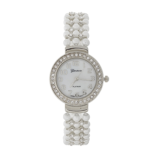 Silver tone watch with a pearl beaded band and clear rhinestone accents.