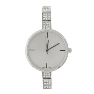 Skinny band, metal watch with a monochromatic face and clear rhinestones along the band.