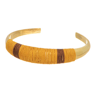 Gold tone cuff bracelet with a citrine and brown thread wrapped focal.