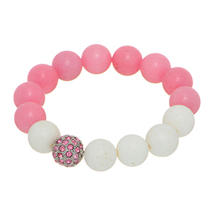 Stretch bracelet featuring white and pink beads with a silver tone pave ball.