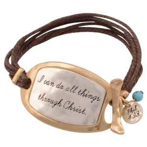 """Brown chord toggle bracelet featuring a two tone plate stamped """"I can do all things through Christ."""", a turquoise bead, and a silver tone disk stamped """"Phil 4:13"""". Approximately 7"""" in length."""