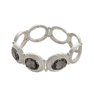 Matte silver tone stretch bracelet with oval black diamond rhinestones.