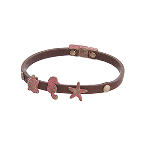 Brown faux leather magnetic bracelet featuring turtle, seahorse, and starfish charms with a coral patina finish.