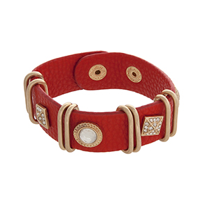 "Red soft faux leather snap bracelet with rhinestone studs, pave squares, and gold tone rings. Approximately 8"" in length."