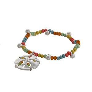 Multicolored beaded stretch bracelet with a silver tone sand dollar charm.
