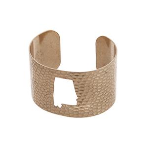 Gold tone hammered Alabama state cuff bracelet.