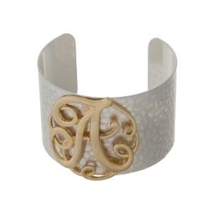 Hammered silver tone cuff bracelet with a gold tone script 'A' initial.