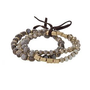 Stretch bracelet set with gray, ivory, and champagne colored beads.
