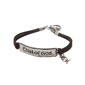 """Brown faux suede toggle bracelet featuring a silver tone stamped Child of God bar with a cross charm. Approximately 9"""" in length."""