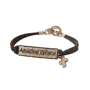 """Brown faux suede toggle bracelet featuring a gold tone stamped Amazing Grace bar with a cross charm. Approximately 9"""" in length."""