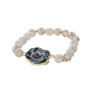 Giraffe bead stretch bracelet featuring a blue agate natural stone.