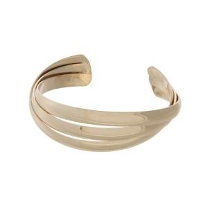 Adjustable gold tone cuff bracelet.