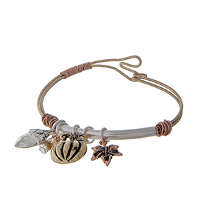 Gold tone bangle bracelet with fall themed charms.