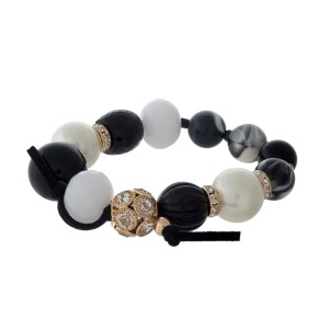 Black, pearl and ivory beaded cord bracelet with clear rhinestones.